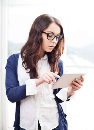 Pretty woman using her digital tablet
