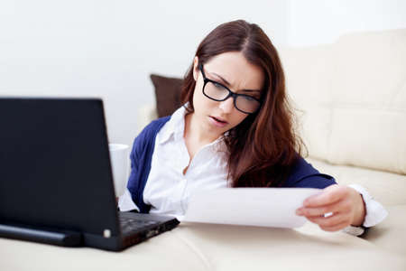 working woman: Busy young woman working at home