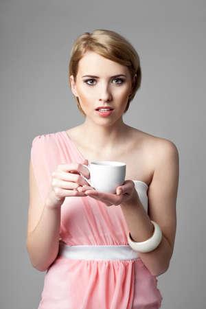 cofffee: Beautiful blonde woman drinking cofffee