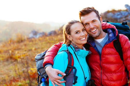 couples: Young couple in mountains smiling