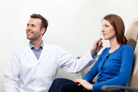 medical attendance: Optometrist doing sight test for female pateient