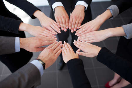 working with hands: Business people joining hands. Team work