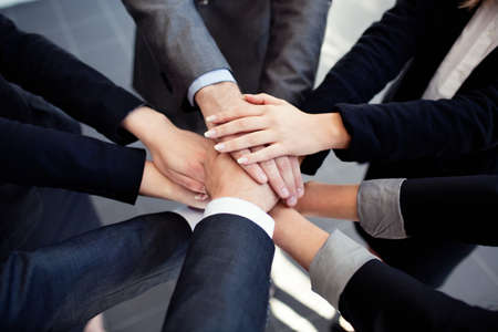 working with hands: Group of business people joining hands. Stock Photo