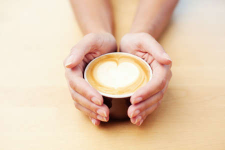 Female hands holding caffee Stock Photo