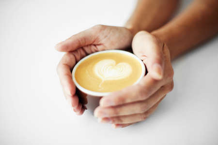 caffee: Female hands holding caffee with heart symbol