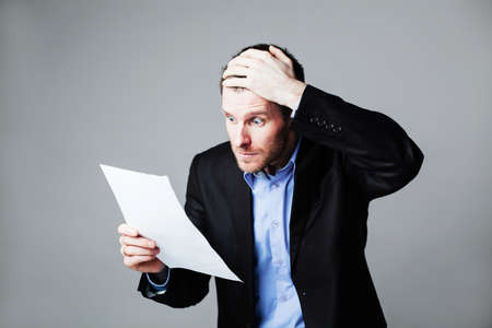 people thinking: terrified businessman reading document Stock Photo