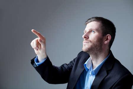 thirties portrait: Portrait of handsome businessman pointing