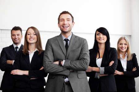 human resources manager: Group of business people with businessman leader on foreground Stock Photo