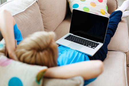girl home: Woman relaxing with laptop on couch