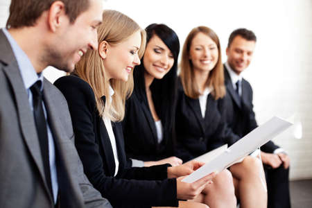 female teacher: Gruop of business people. Businesswoman explaining