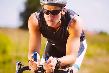 velo: Triathlete cycling on a bicycle