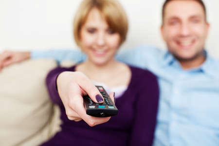 Young couple watching tv 스톡 콘텐츠