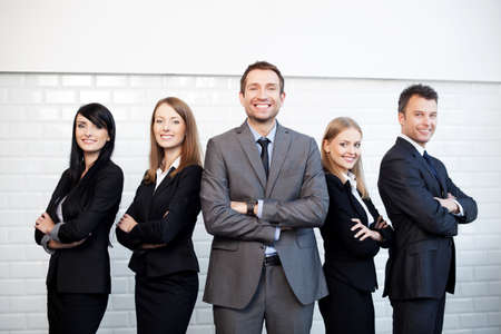 Group of business people with businessman leader on foreground. Stock Photo