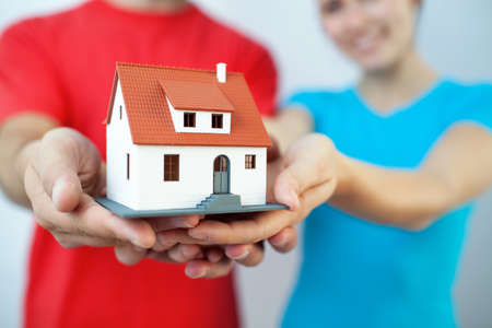 hands holding house: Buying new house concept Stock Photo