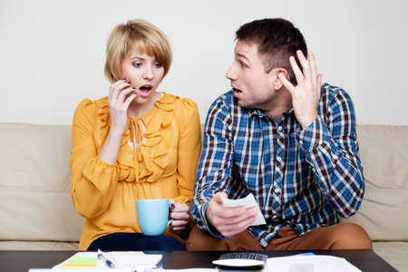 paying: Shocked couple paying bills. She just buy too much.