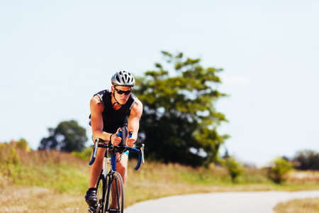 exercise bike: Triathlete cycling on a bicycle
