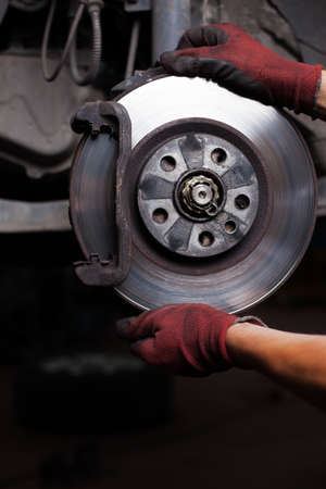 Repairing brakes on car. Changing brake disc