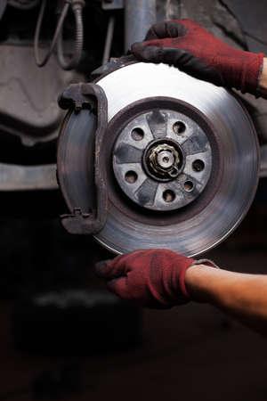 brakes: Repairing brakes on car. Changing brake disc