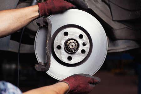 shop skill: Brake repair. Mechanic changing brake disc