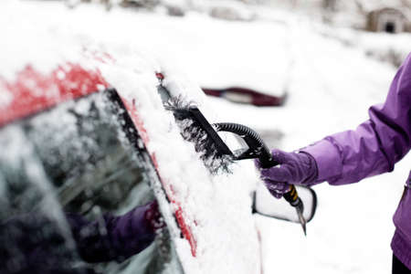 scraping: Removing snow from windshield