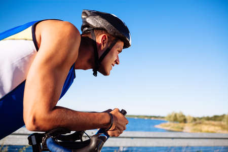 triathlete: triathlete cycling on a bicycle Stock Photo