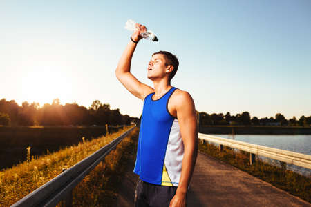 young guy: Runner cooling down after running. Health and fitness concept. Stock Photo