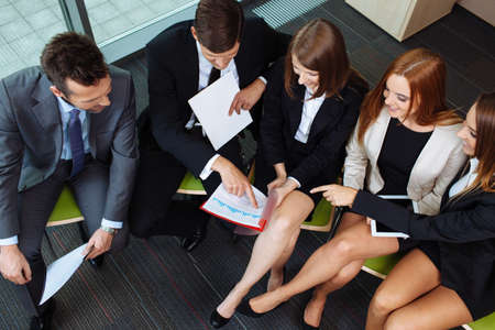business woman legs: Businessman pointing on chart during business meeting.