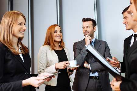 smilie: Business people talking during conference break; networking Stock Photo