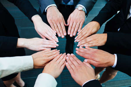 joining hands: Business people joining hands Stock Photo