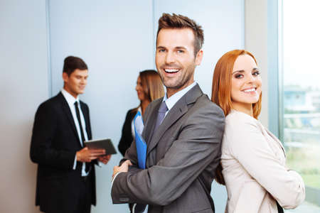 business relationship: Group of successful business people with leaders in foreground Stock Photo