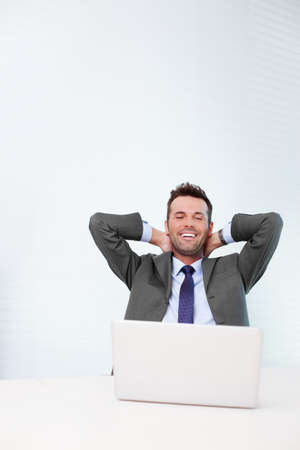 hands on head: Successful businessman resting in the office