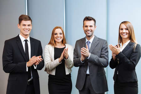 Corporations: Group of successful business people clapping their hands Stock Photo