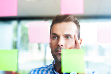 thoughtful man working in the office
