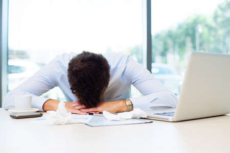 cold virus: Sick man sleeping at work in the office