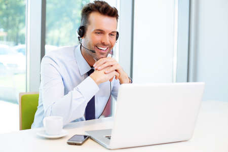 Businessman during conference with headset 스톡 콘텐츠