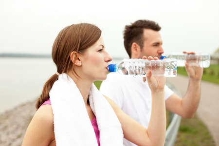 drink water: Couple drink water after running Stock Photo