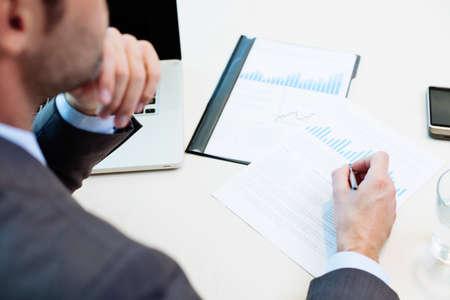 market analyze: Market analyze. Businessman doing paperwork Stock Photo
