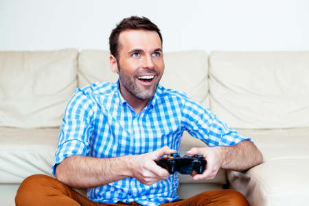 video game: Adult man playing a video game Stock Photo