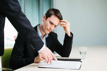 Unhappy business man listen to his boss Foto de archivo