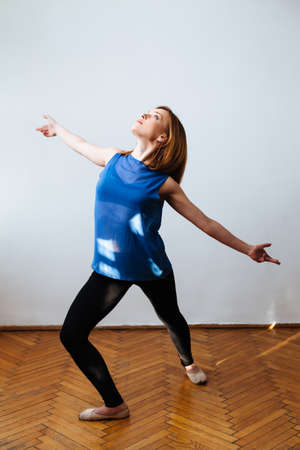 poise: Ballerina with stretched arms perfecting the poise Stock Photo
