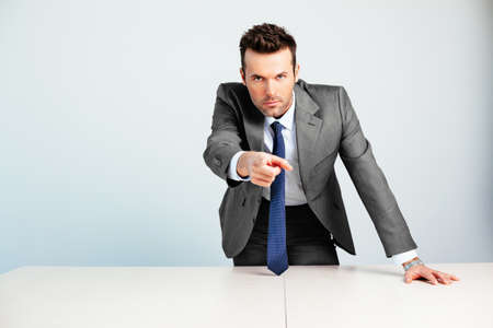 Young decided businessman pointing at camera Standard-Bild
