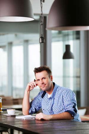 Relaxed man enjoying a cup of coffee and thinking Lizenzfreie Bilder