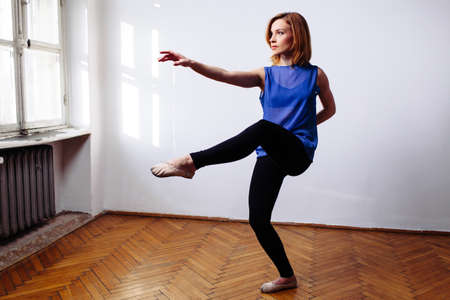 female legs: Ballerina practising the moves Stock Photo