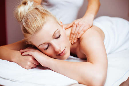 causcasian: Attractive young woman having a massage at a day spa Stock Photo