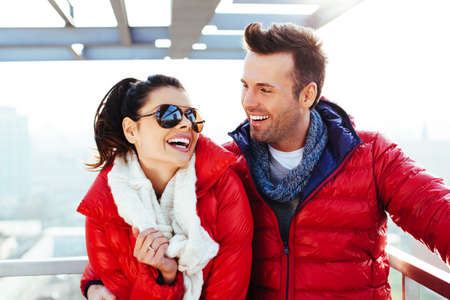 life jackets: Happy couple at roof top hugging and laughing Stock Photo