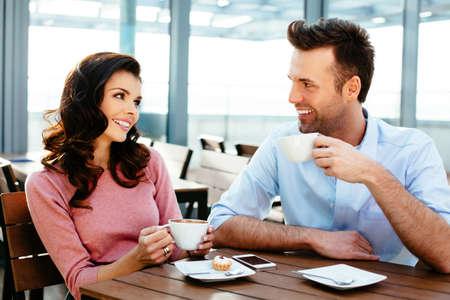 brak: Attractive couple having a conversation  in a canteen