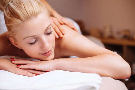 Blonde beauty during a back massage Stock Photo