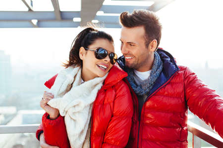 Young couple together at rooftop smiling Stock Photo