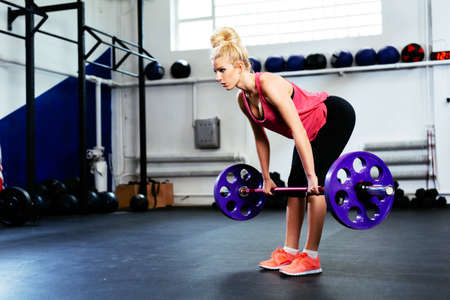Young woman doing Straight Leg Deadlift exercise Stock Photo - 96048802