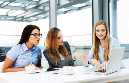 Group of discussing female managers in a corporate meeting